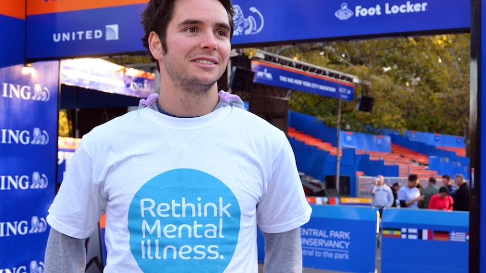 Kevin wearing a Rethink Mental Illness t-shirt