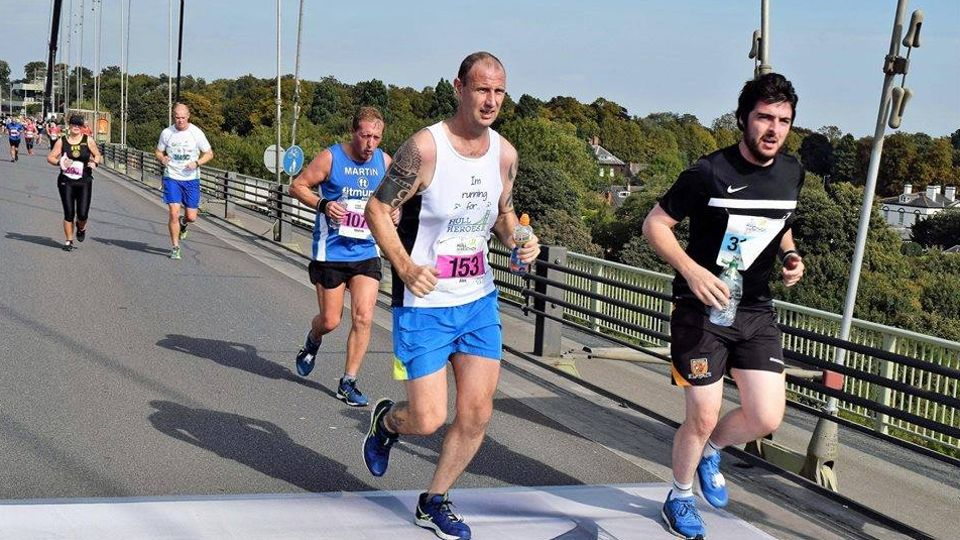 Runners in the Hull Marathon crossing the Humber Bridge