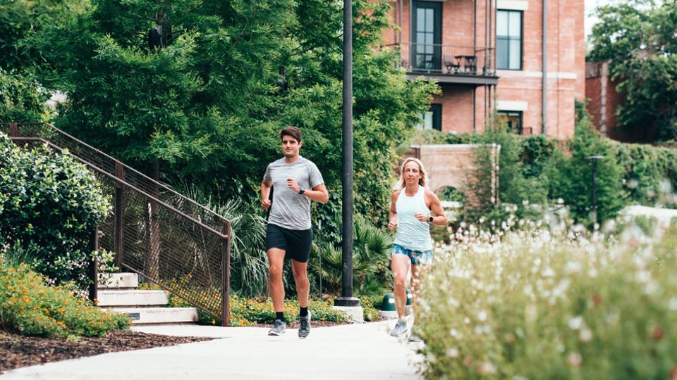 Two runners in a scenic, suburban area