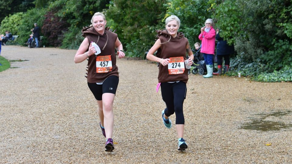 Two female runners in themed outfits at the Hedgehog Half Marathon