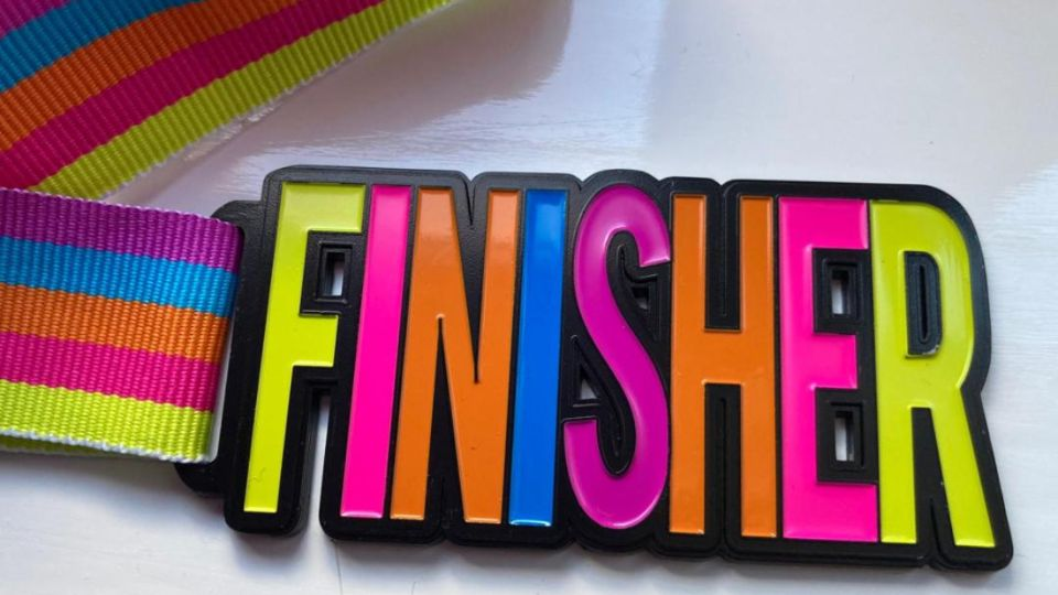 Brightly coloured finisher medal for March virtual 5K challenge