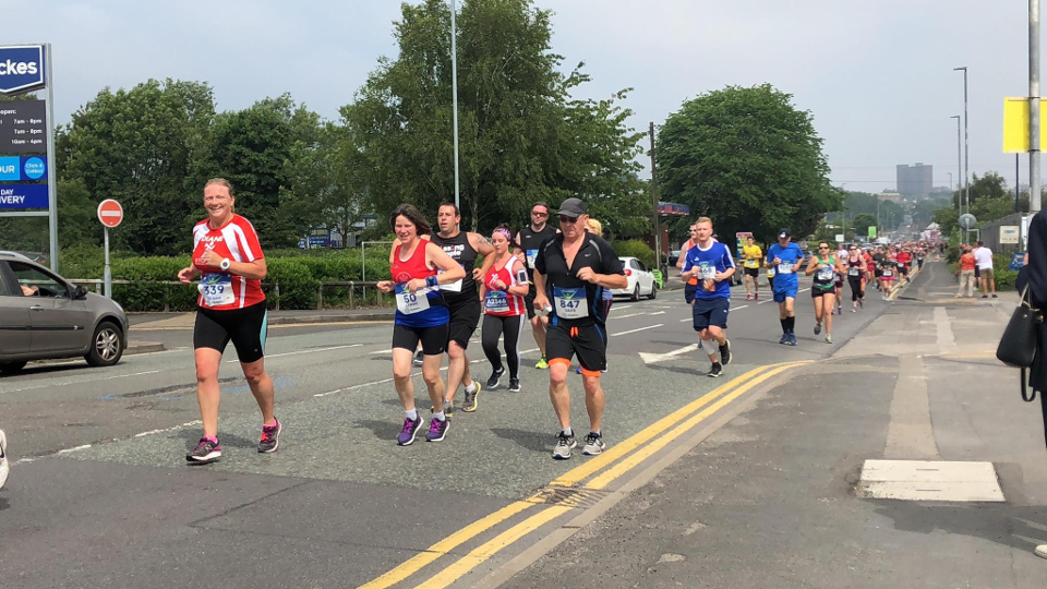 Running up Anchor Road in the Potters Arf Marathon