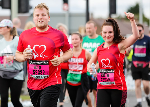 Two happy runners in BHF vests at Great North Run