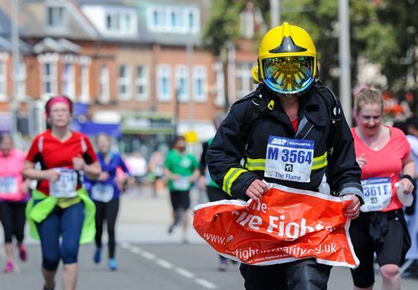 Runner in fire fighter gear