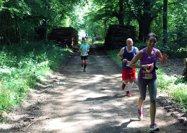 runners going along a shady Wiltshire trail