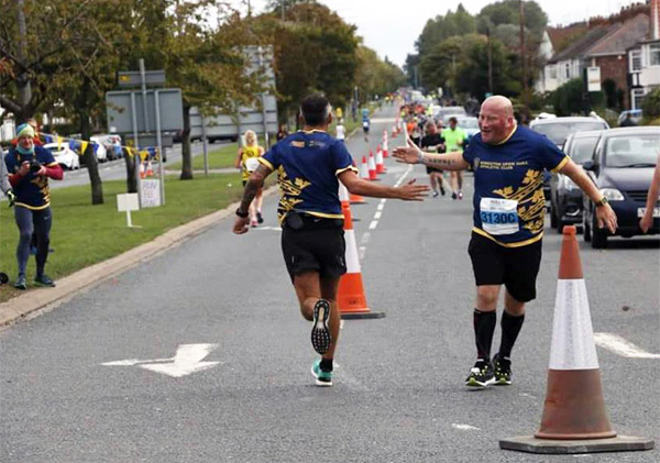 runners enjoy a friendly hand slap at Hull Marathon