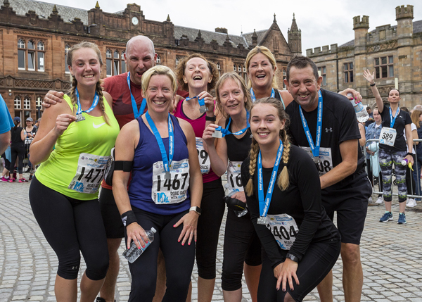 Paisley 10K finishers show off their medals
