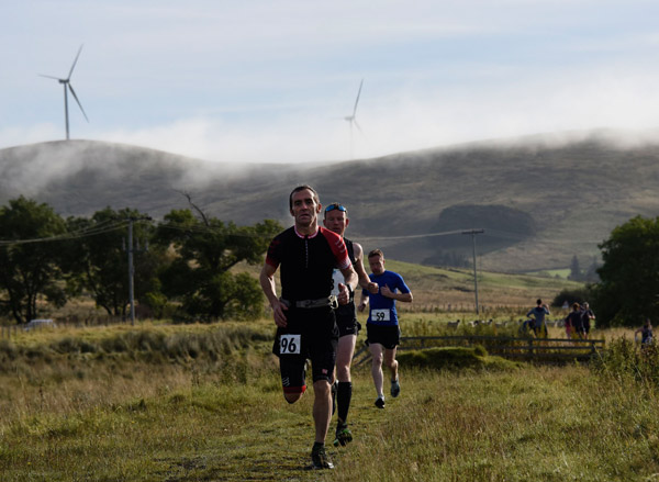 runners on a scenic part of the River Ayr way ultra