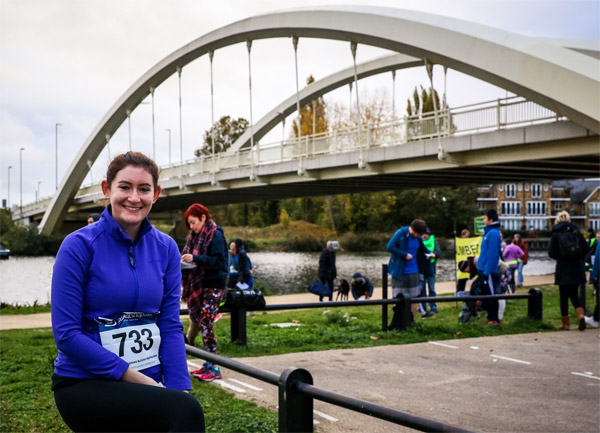 Finisher in front of the Walton Bridge