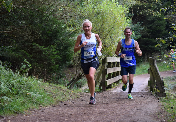 Woman trail racing on Forest of Dean paths
