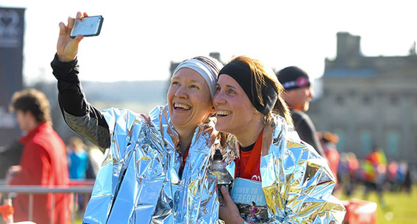 Two happy runners take selfies after Harewood House race