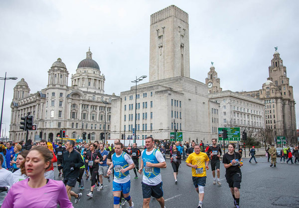 runners with great Liverpool skyline backdrop