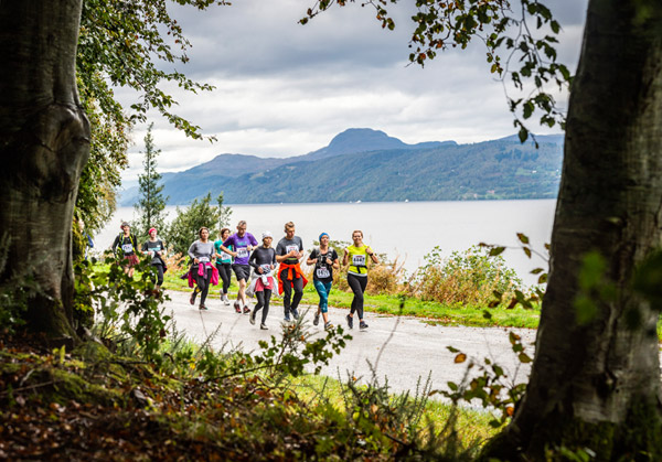 great lochside view of runners at Loch Ness Marathon