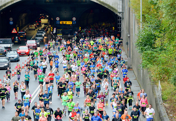 runners coming out of the Mersey Tunnel