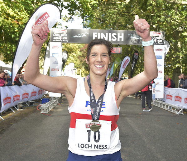 Sheena Logan clebrates after winning at Loch Ness Marathon