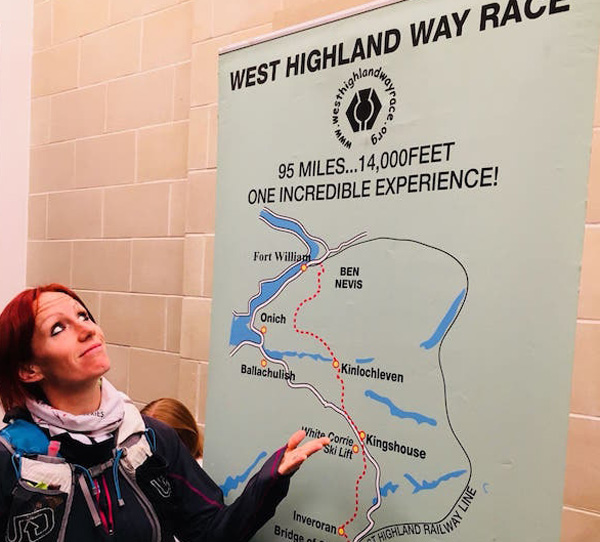 runner consults West Highland Way race route on wall