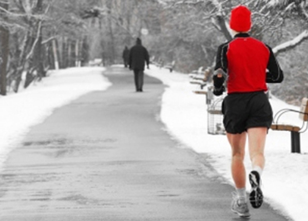 Shot of a runner with a Santa hat on a snowy day