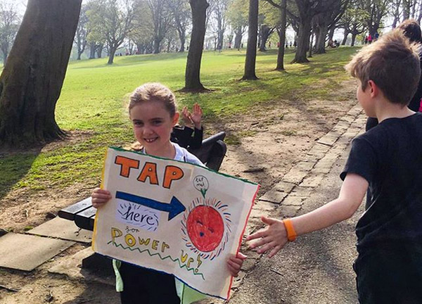 young supporter with power-up sign at Kirkcaldy Half 2019