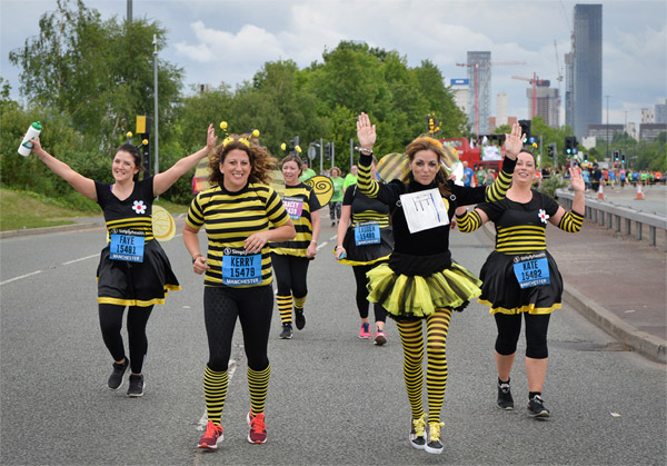 Runners in bee outfits