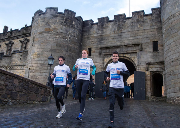 runners with Stirling Castle backdrop