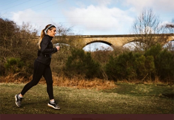 Solo female runner in the countryside