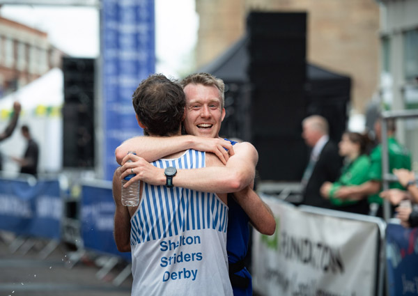 Runner hug at Derby Half