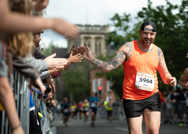 Runner high 5s at Derby Half