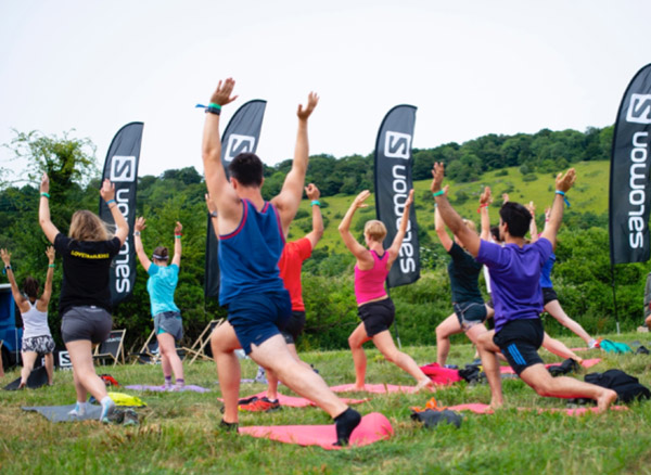 trail runners stretching out at a Salomon camp