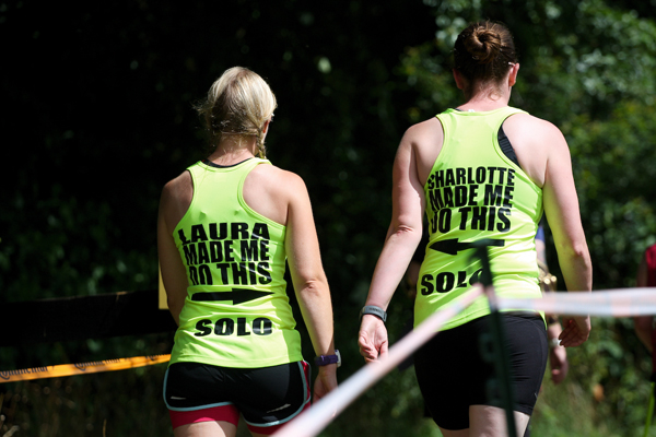 Two runners with humerous T-shirts at a 24 hour race