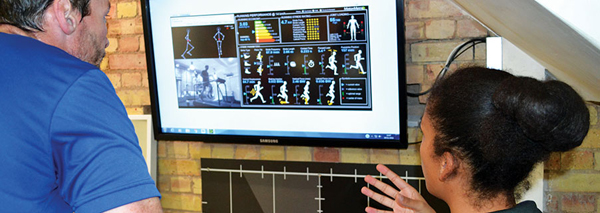 runner is shown movement analysed on screen